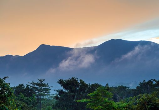 Colorful Sky and Clouds drifting over the forest mountain in eve