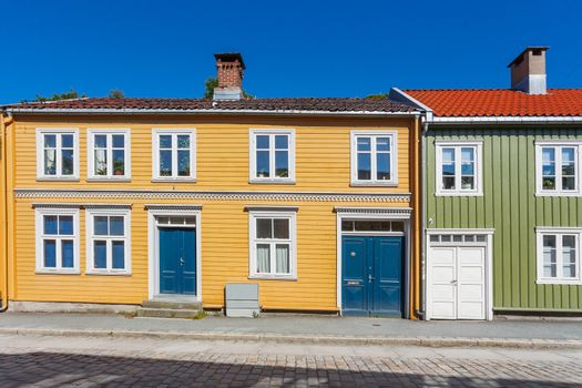 Colorful buildings on streets with cobbled pavement. Scandinavia