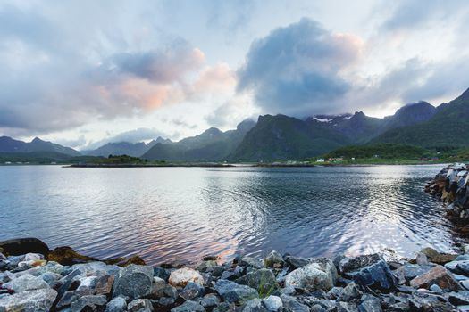 Beautiful scandinavian seascape with village, mountains and fjor