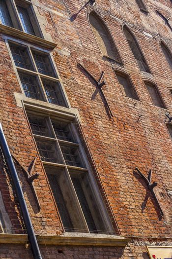 Tie rod anchor plates on brick wall of historic town hall in Gdansk, Poland