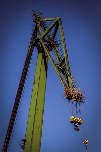 Large green single boom shipyard crane in Gdansk shipyard, where Solidarity movement was founded in September 1980