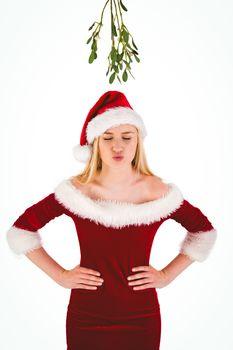 Festive cute blonde under mistletoe