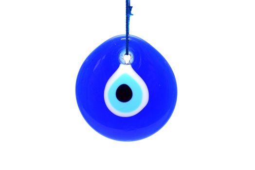 evil eye symbol amulet over white background