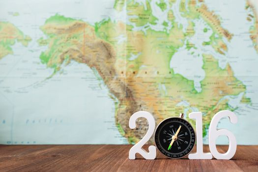 Travel in 2016 year. Numbers 2016 with magnetic compass. Blurred