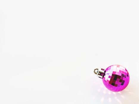 New Year background with magenta ball. Pink reflections, sunbeam