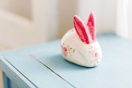 Hare porcelain figure with bright red hand painted ears and rose
