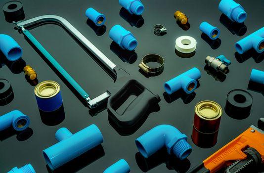 Plumbing tools. Plumber equipment. Blue PVC pipe fittings, hacks