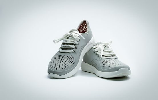 A pair of grey shoes on white background. Comfortable shoes with
