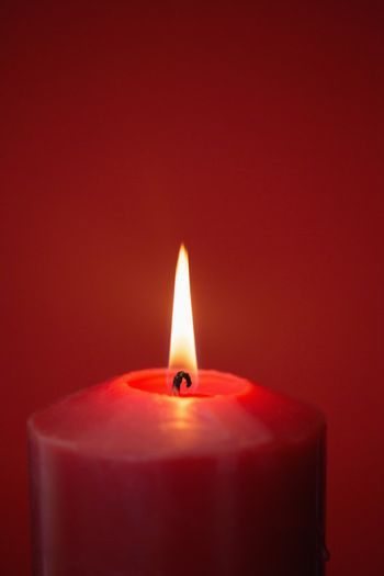 Red candle burning brightly
