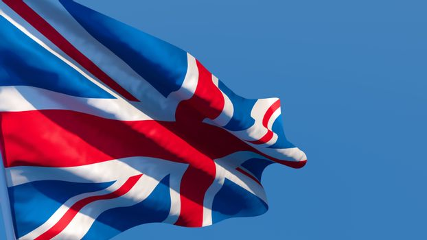 3D rendering of the national flag of British waving in the wind against a blue sky