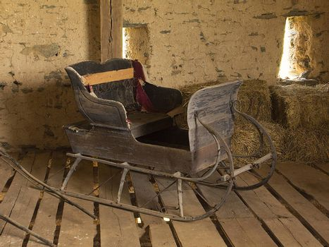 Old horse-drawn sleigh sitting in old barn