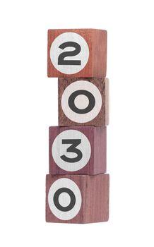 Four isolated hardwood toy blocks, saying 2030