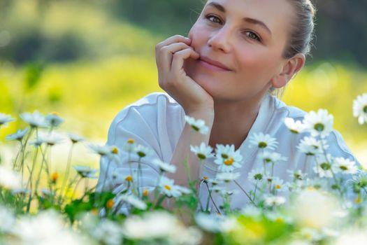 Nice female on daisy field