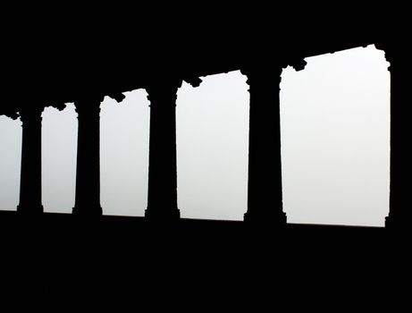 Colonnade black pillars seen in perspective and fog