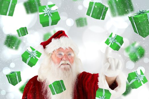 Santa claus pointing against white glowing dots on grey
