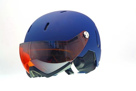 Isolated kids ski helmet with snow goggles.
