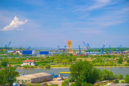 Industrial cargo port skyline, loading cranes in Tulcea on Danube river