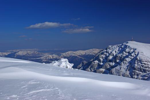 Mountain rock summit landscape. White mountain top in Romanian Carpathians, winter scene.