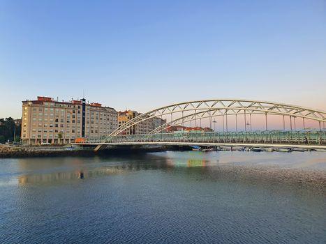 Arch bridge in Pontevedra, Currents Bridge in Spain, urban sunset landscape at Lerez river