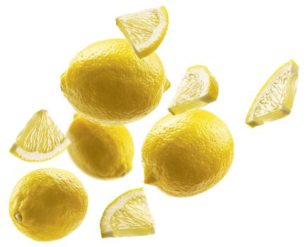 Yellow lemons levitate on a white background.