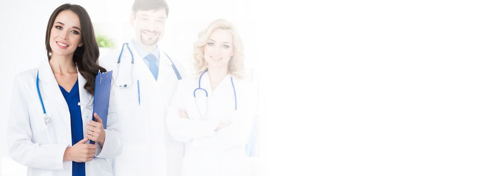 A medical team of doctors, men and woman, isolated on white background with copy space