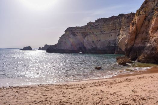 Empty beach between cliffs. Uncrowded travel concept. Algarve, Portugal