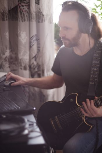 Musician composing music at home
