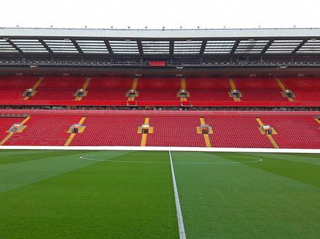 Football stadium with red empty seats