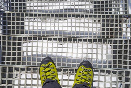 Trekker boots on stairs, winter boots on winter mountain