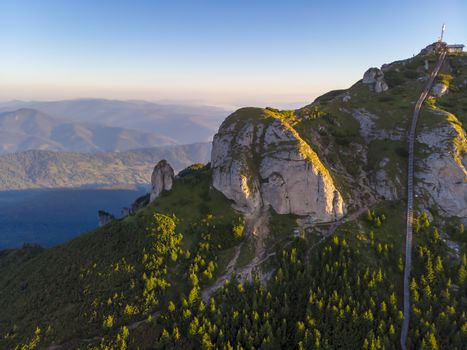 Aerial rocky summit and access stairs in Ceahlau massif, Romanian Carpathians