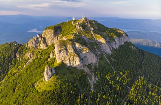 Aerial view of mountain peak: stairs for tourists in a summer landscape, Ceahlau mountain in Romanian Carpathians