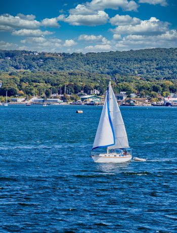 White Sail on Blue Water