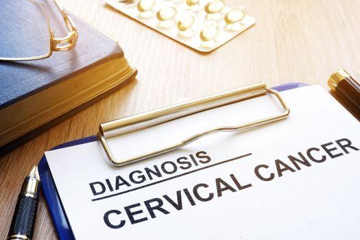 Cervical cancer diagnosis on a clipboard.