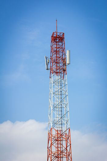 telecommunication tower and background of cloudy blue sky.