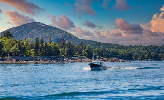 Black Fishing Boat Cutting Through Blue Water