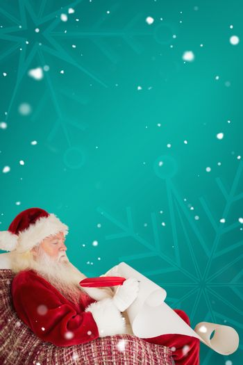 Composite image of father christmas writing list with a quill