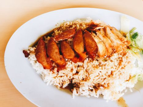 closeup roasted red pork with sweet gravy on steamed rice.