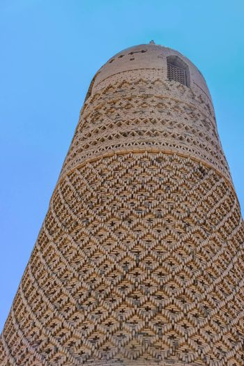 The Emin Minaret in Turpan, Xinjiang, China made with textured bricks that are carved into geometric and floral mosaic patterns