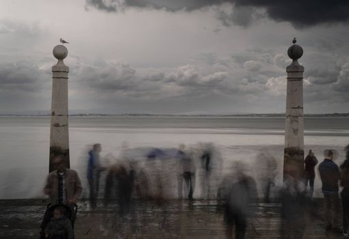 lisbon sea blurry people seagulls cloudy rainy day