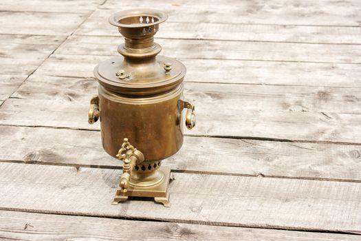 brass samovar on a wooden table