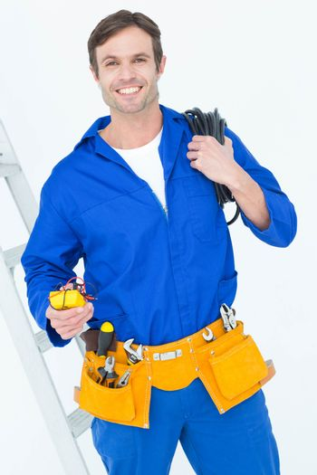 Electrician with wire roll and multimeter