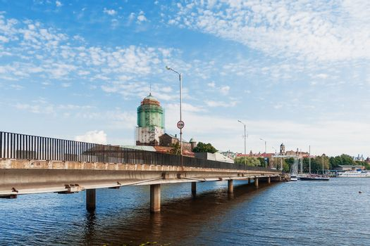 Vyborg castle. Medieval Swedish castle with St. Olav tower during reconstruction. Summer day in in Vyborg, Russia.