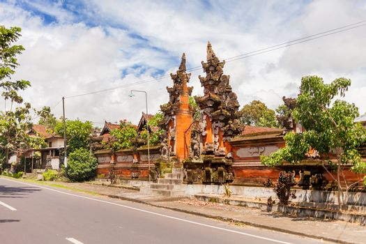 House with figured gate in Ubud, Indonesia. Traditional asian architecture.