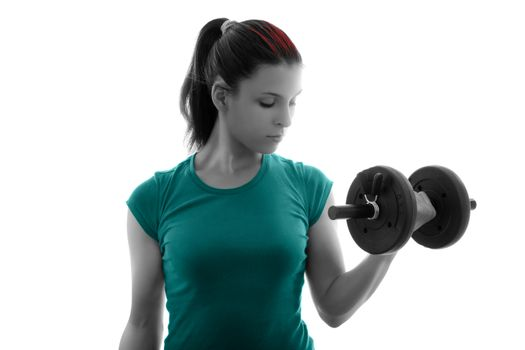 Fit attractive young woman working out with a dumbbell, doing biceps curl, backlit silhouette studio shot isolated on white background. Fitness and healthy lifestyle concept.