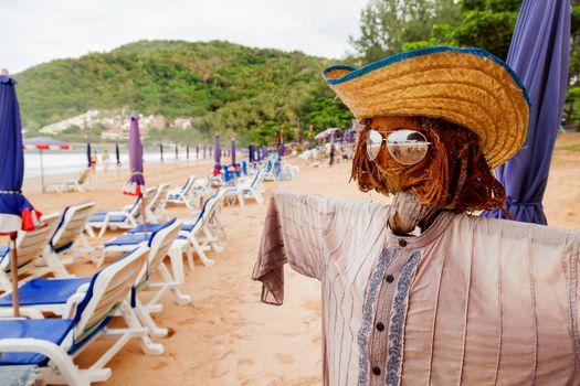Funny scarecrow on beach. Stylish bogeyman on Phuket island, Thailand.