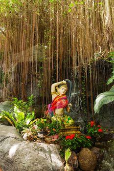 Sculpture in bushes. Golden mount (Wat Saket), Bangkok, Thailand.