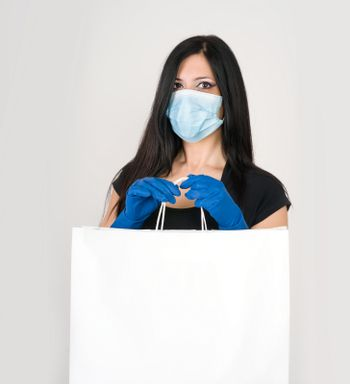 beautiful woman wear medical gloves and mask for prevention with