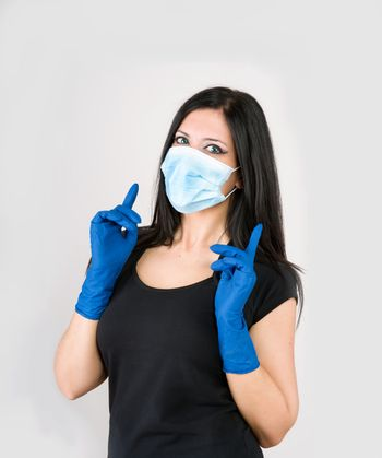 beautiful woman wear medical gloves and mask for prevention
