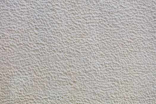 Beautiful uniform beige gypsum texture pattern on the wall