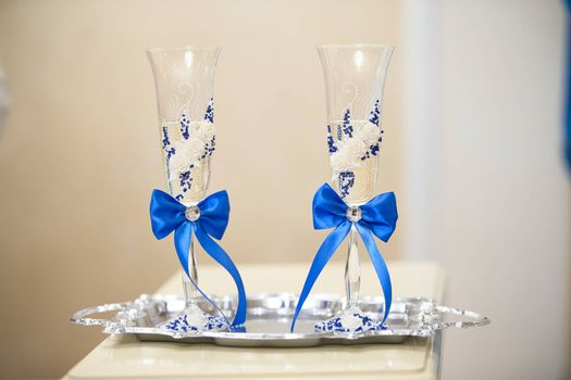 Champagne glasses are beautifully decorated. Two beautiful glasses.